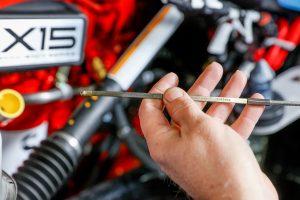 diesel mechanic doing diagnostics