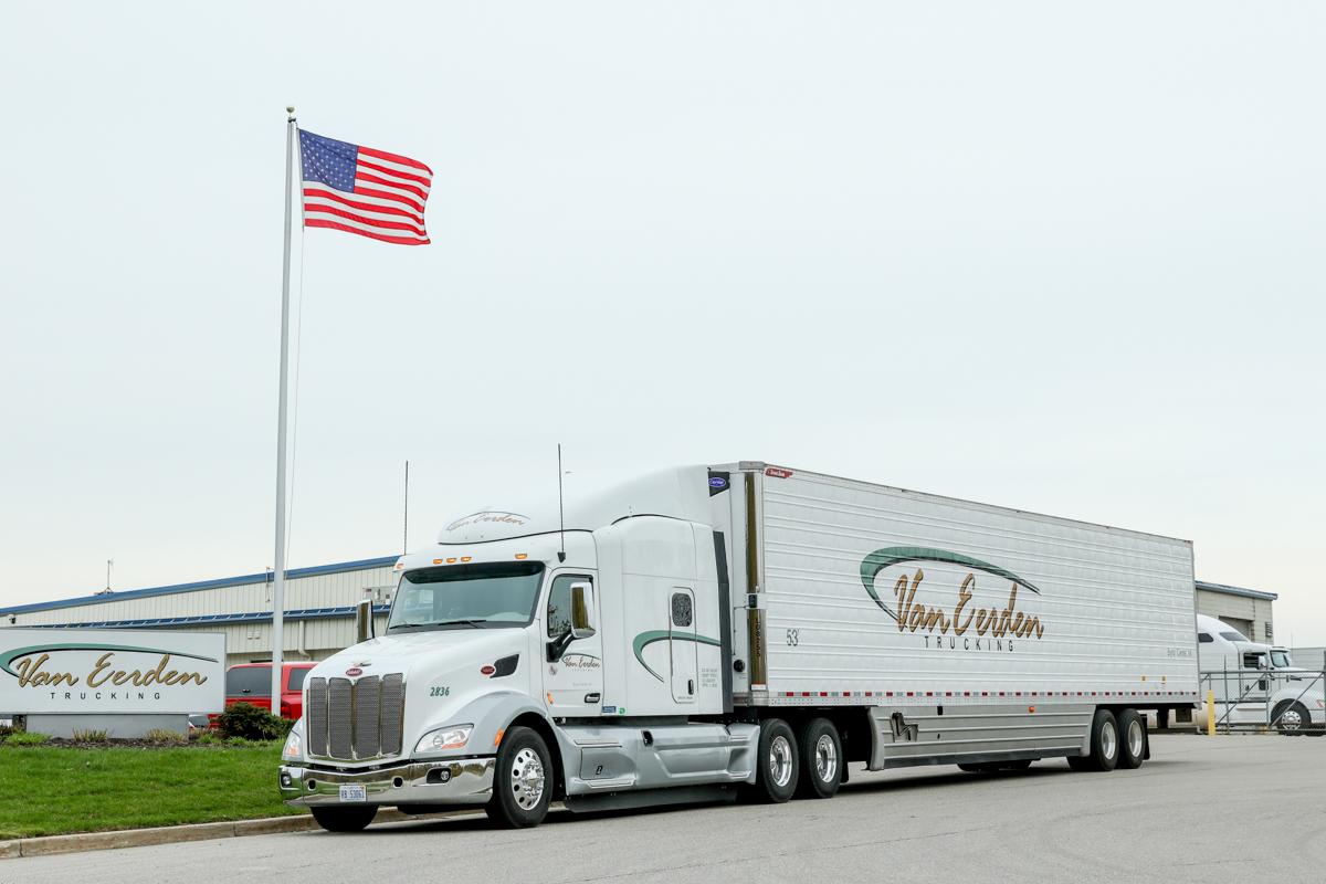 van eerden semi truck with american flag