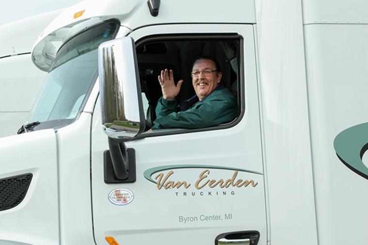 semi truck driver waving