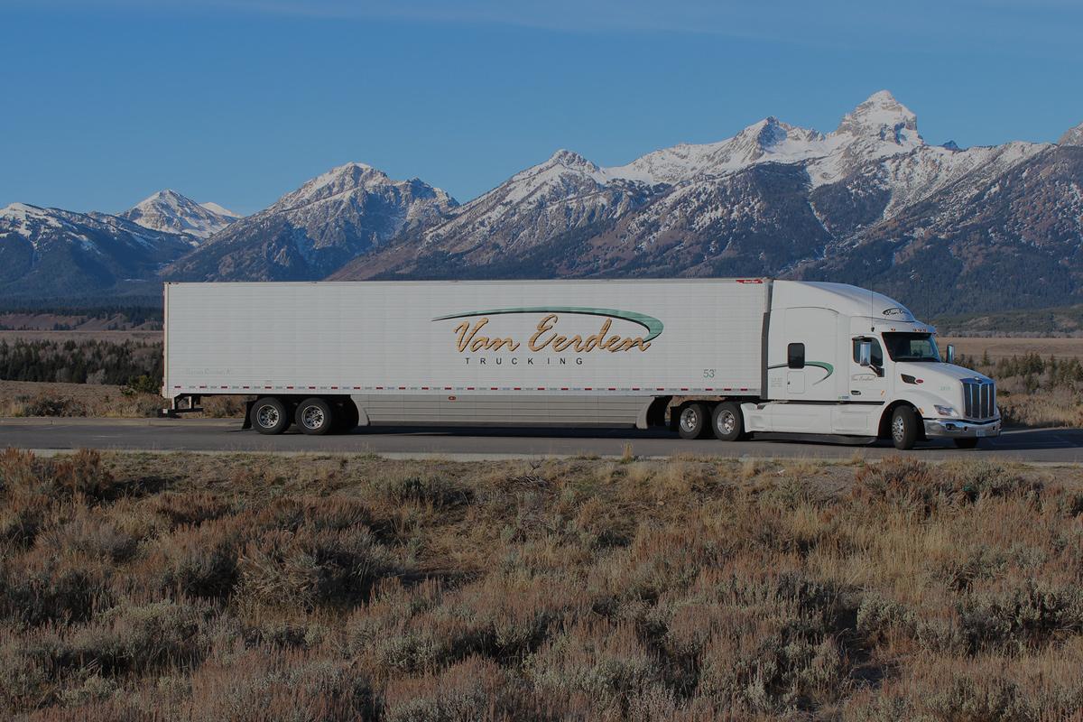 slider background semi truck against mountain backdrop