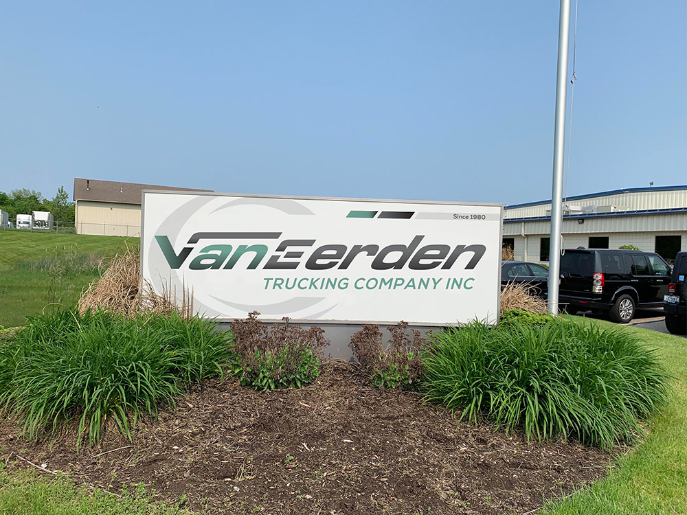van eerden trucking sign near company entrance